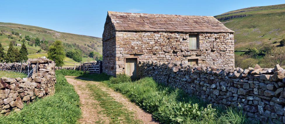 Image showing a derelict stone barn for sale