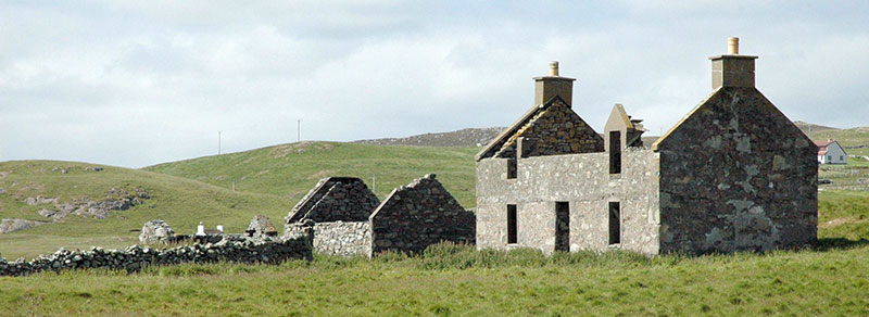 A derelict stone cottage for sale in Scotland.