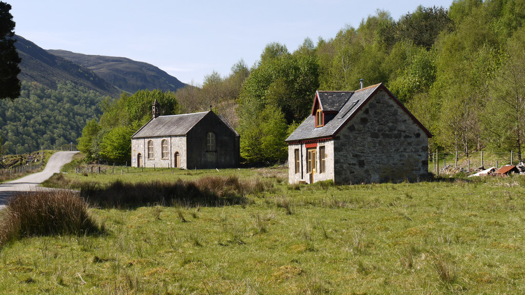 Image showing a disused church and renovated cottage
