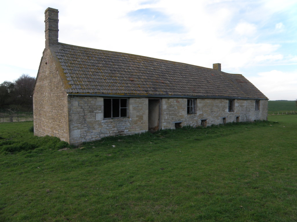 Image showing land with a derelict cottage