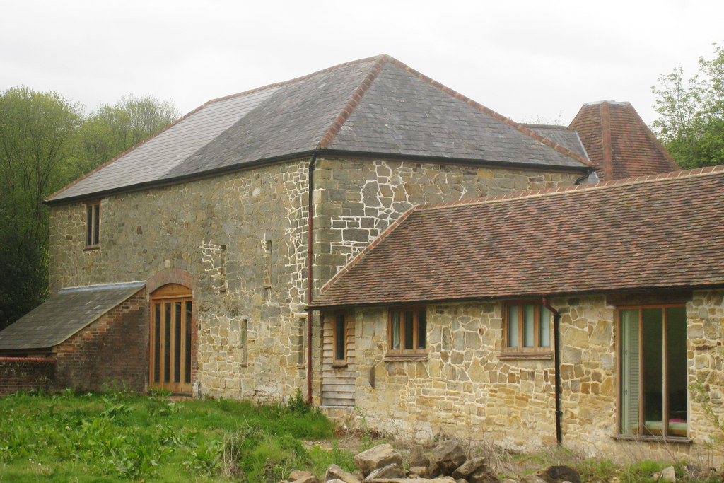 Image showing a renovated derelict barn with land