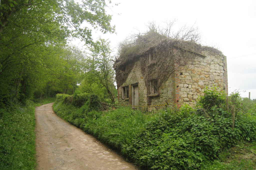 Image showing a rundown house with land