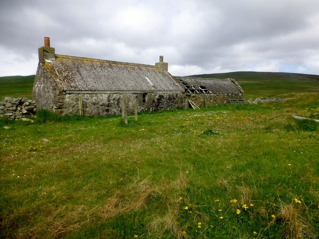 A smallholding in Scotland with a derelict croft house